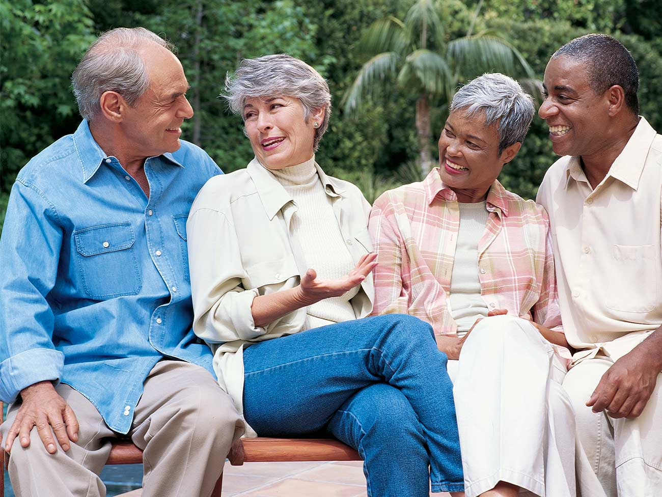 Group of diverse seniors sitting on a bench