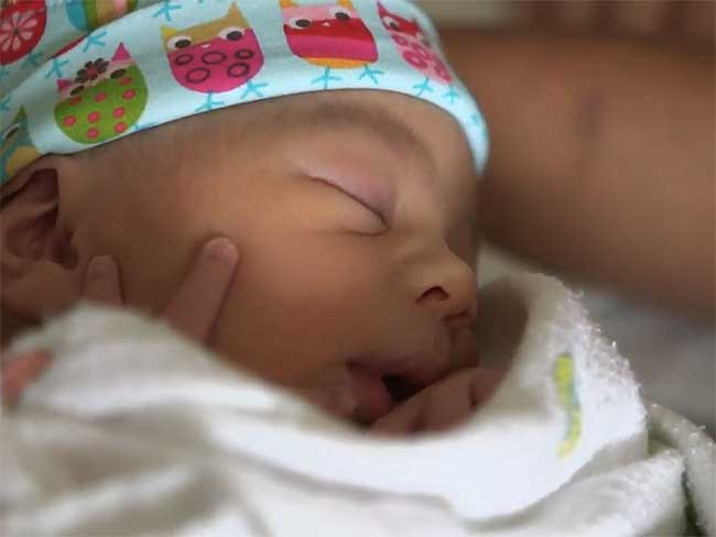 Closeup of a sleeping newborn baby.
