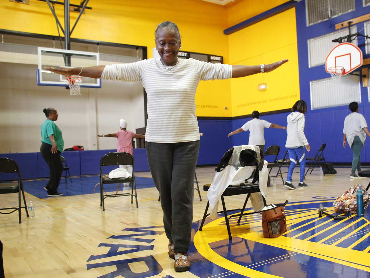 Breast cancer survivor Sandra Domingue does a balance exercise at her local YMCA.
