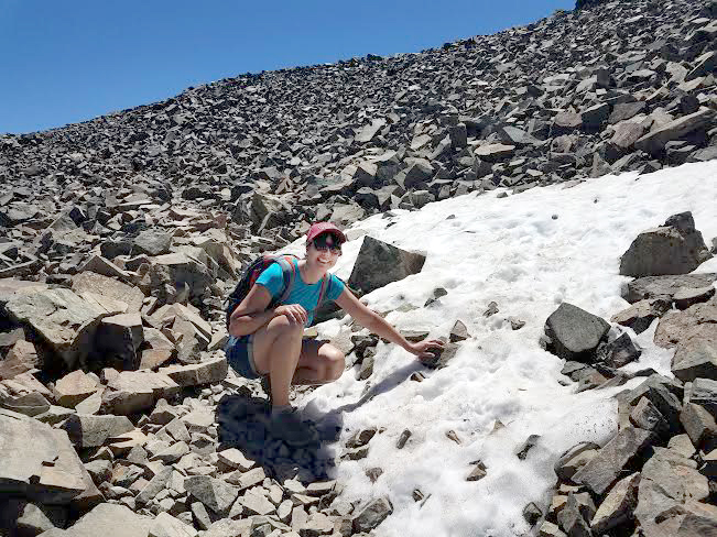 Claudia Nau, PhD, after summitting Mount Tallac near Lake Tahoe