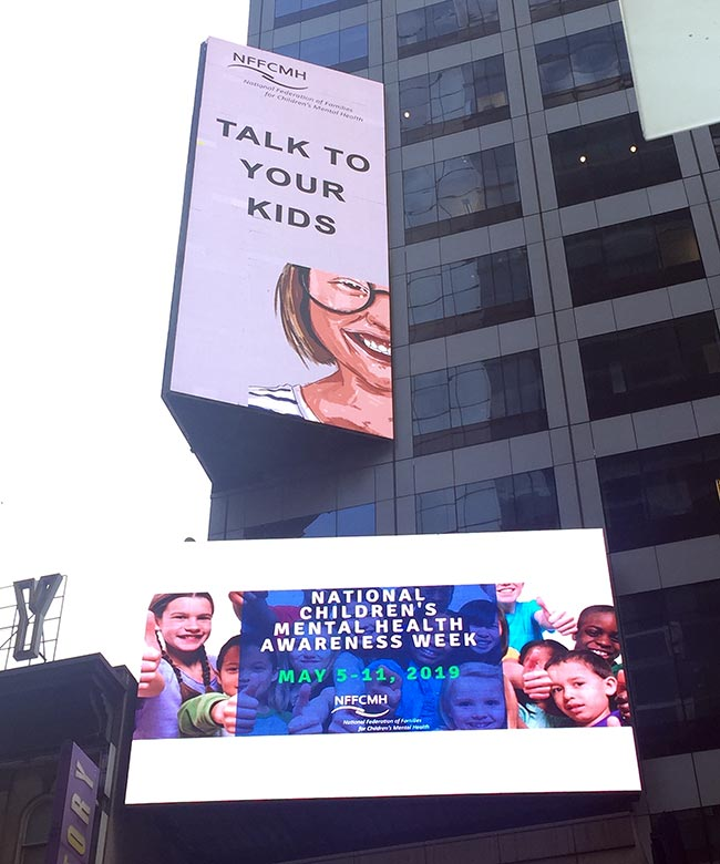 An ad created by the Action Minded campaign for a partner community organization in New York's Times Square.