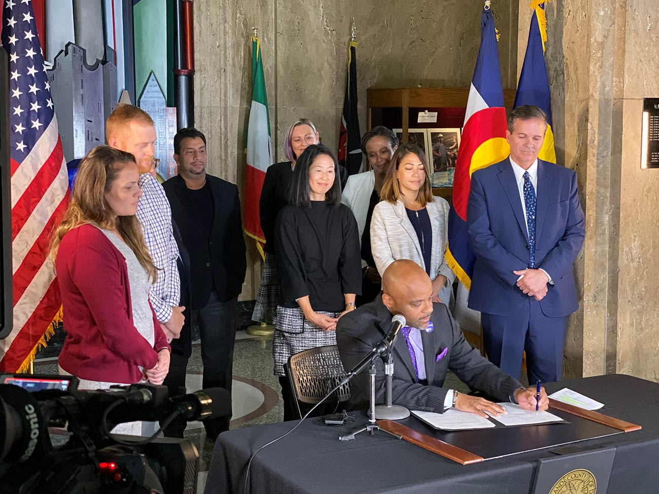 Denver Mayor Michael Hancock signs the city's new Tobacco 21 law in October 2019.