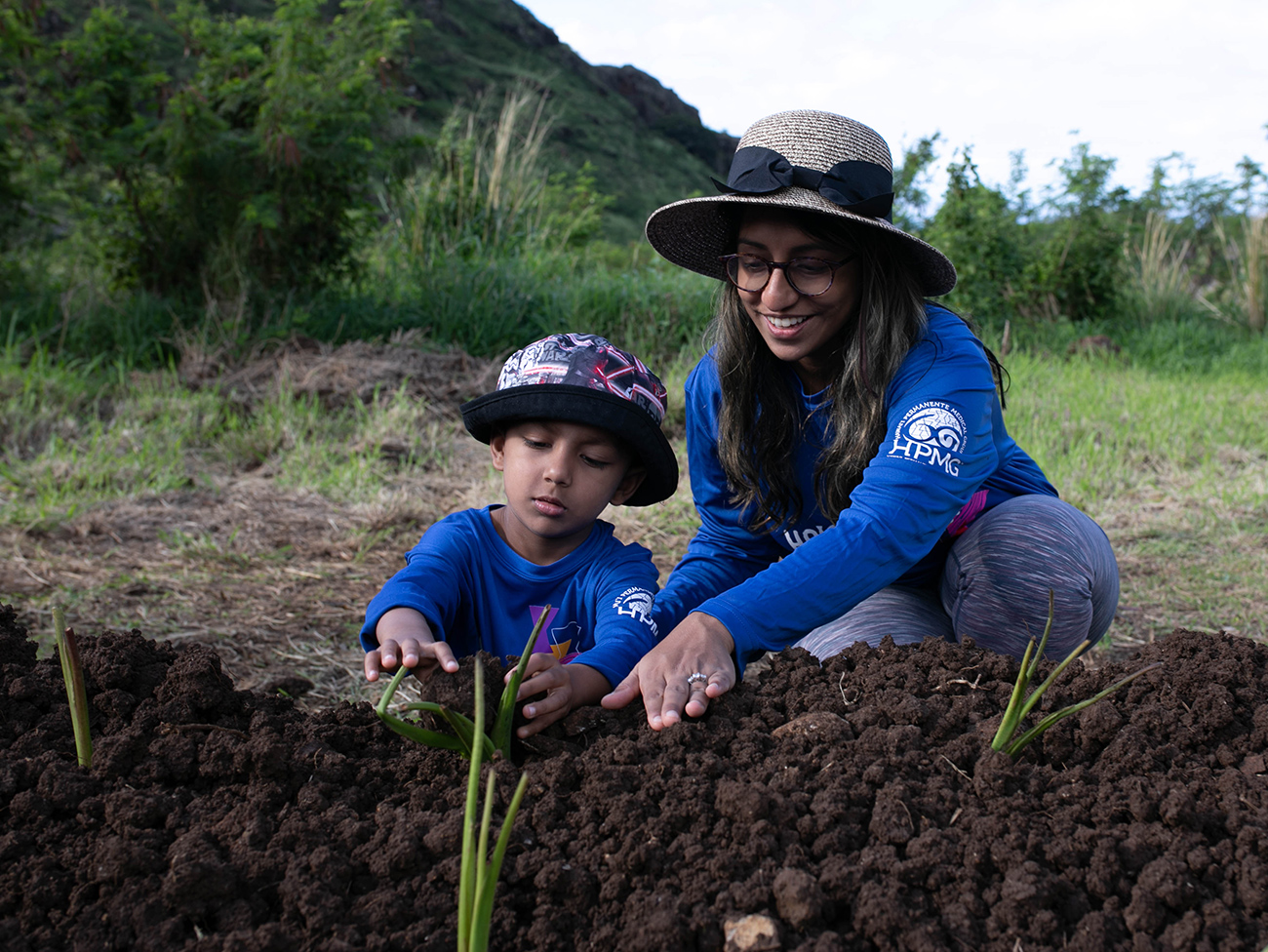 Dr. Debleena Dutt planting native greenery at Ka`ala Cultural Learning Center