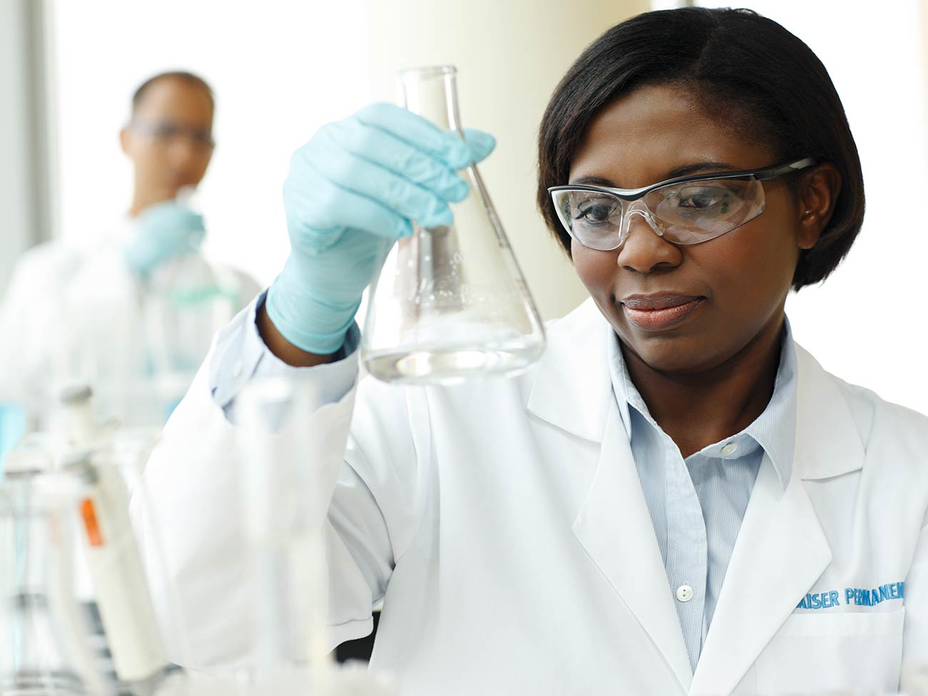 Female African American researching in a laboratory.
