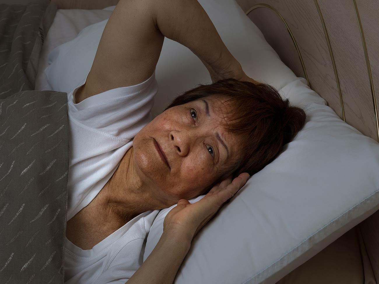senior woman having trouble sleeping