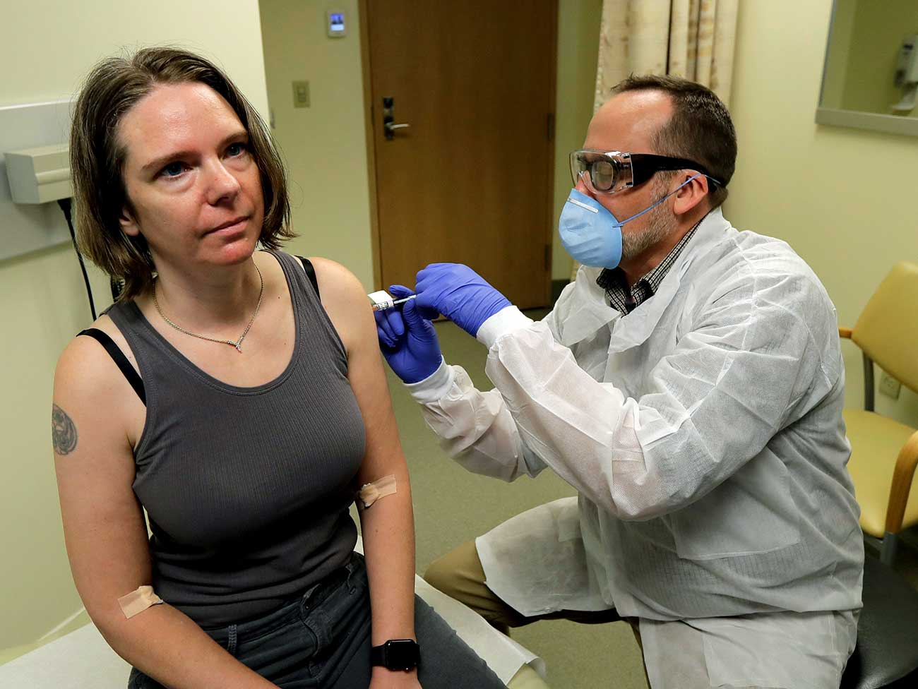 Jennifer Haller receives the first injection in first trial of a vaccine for the new coronavirus on March 16, 2020.