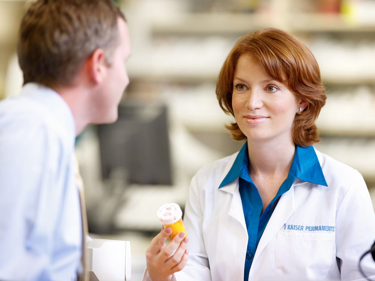 woman pharmacist speaking to customer