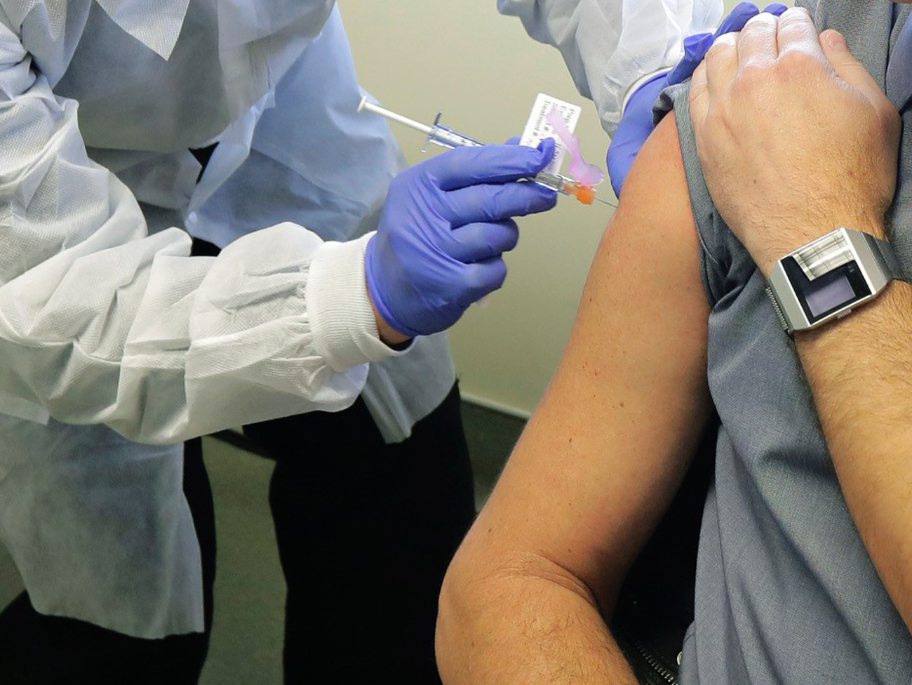 man receiving a vaccination shot