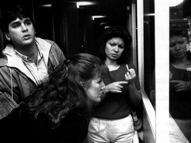 Jose and JoAnne Coelho, who are deaf, tour Portland, Oregon's Bess Kaiser Medical Center in 1988 with interpreter Luann Cook.