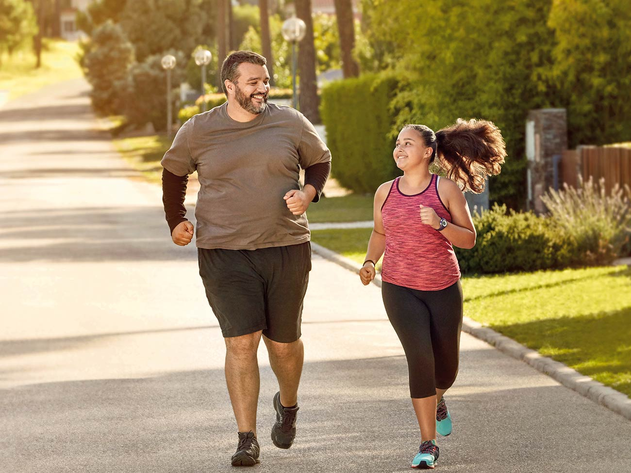 father and daughter jogging
