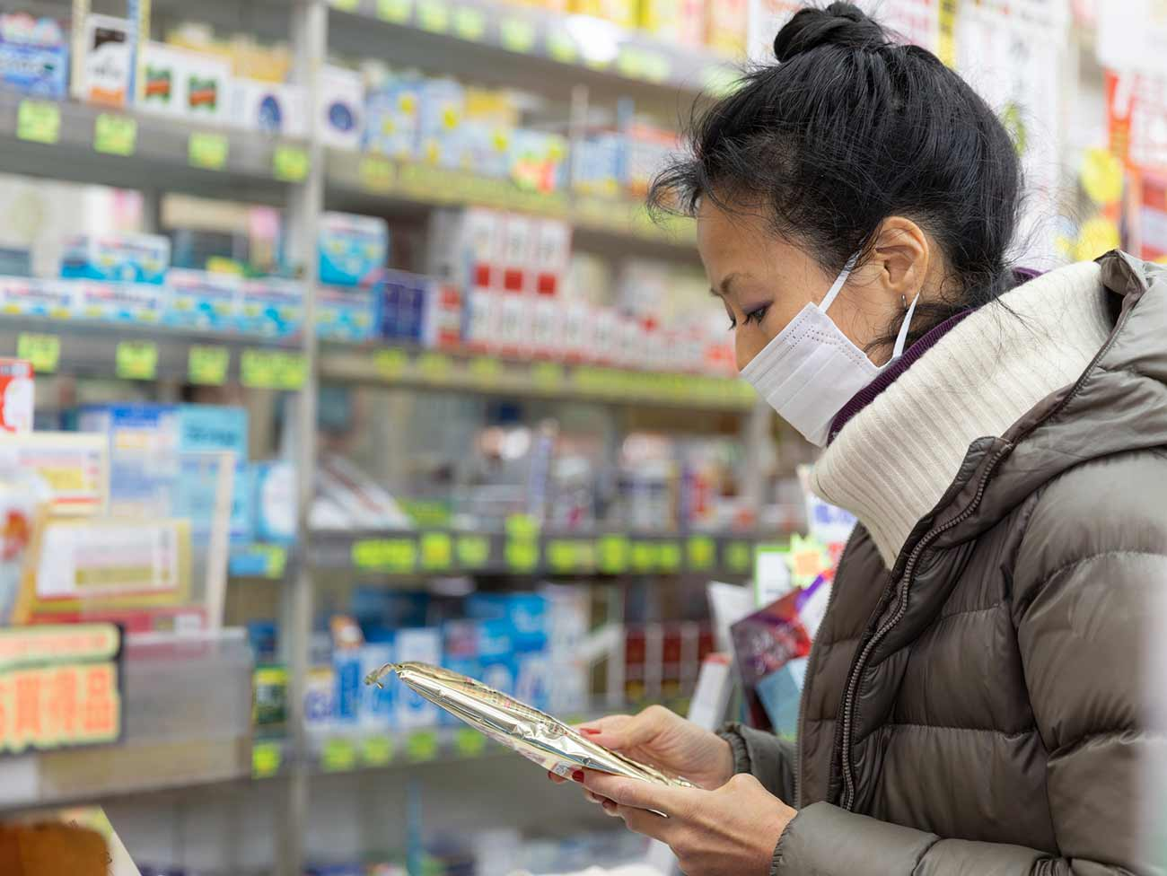 Japanese woman shopping at pharmacy