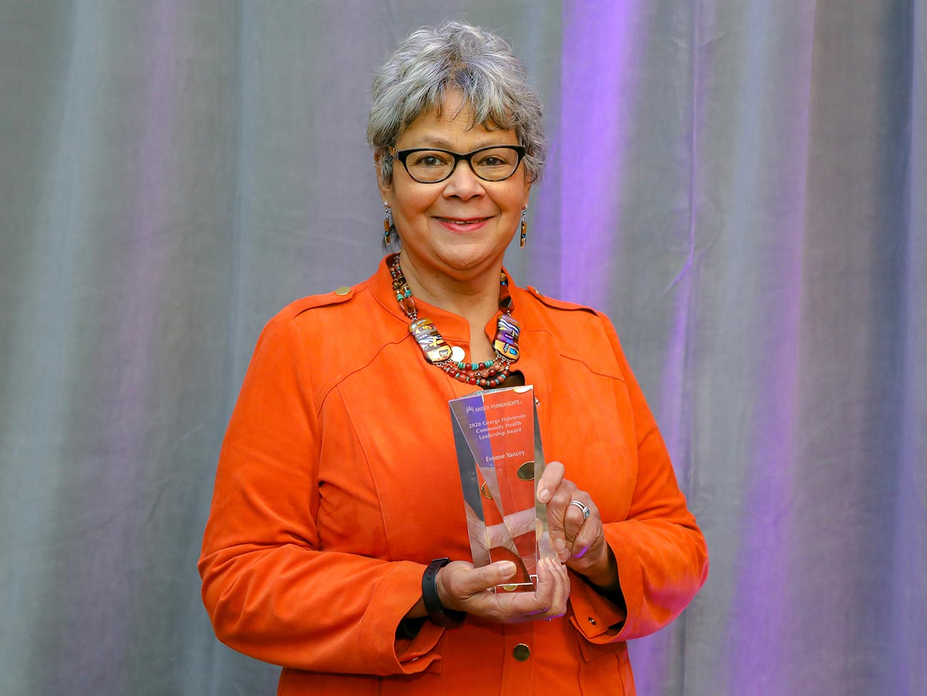 Evonne Yancey holding the Halvorson award trophy