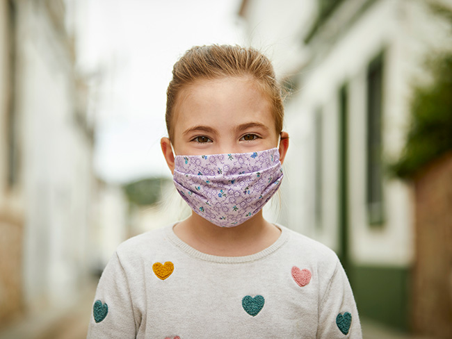 young girl wearing cloth face mask