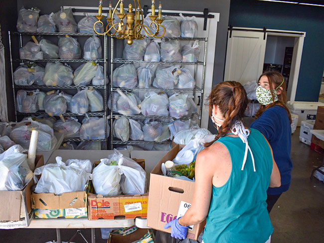 Maui FoodBank volunteers sort food for distribution to those in need.