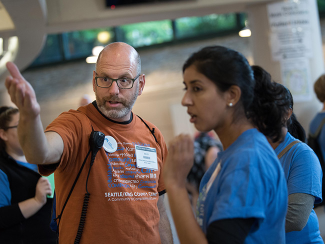 David Efroymson directs volunteers at the Seattle King County Clinic