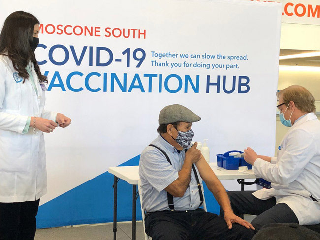 Man receiving his COVID-19 vaccine at the Moscone Center event